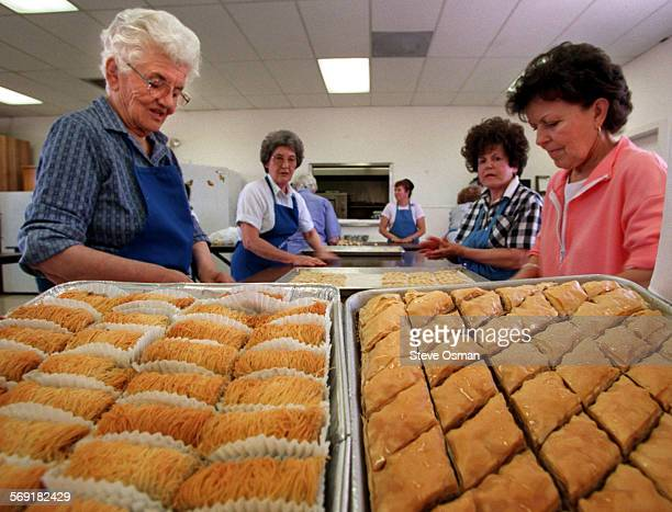Members of the St Demetrios Greek Orthodox church in Camarillo prepare Koulourakia in background Baklava on right and other Greek pastries in the...