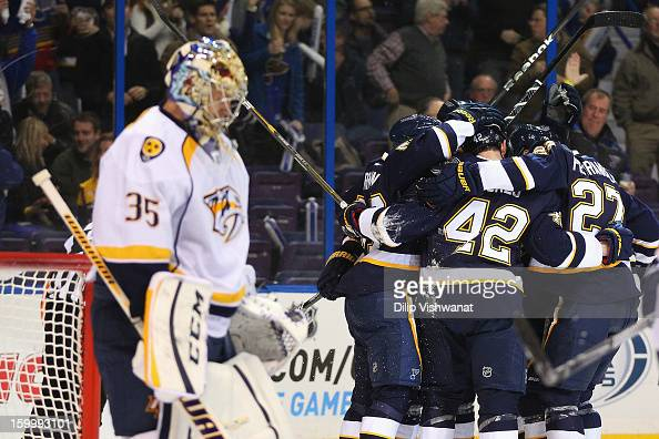 Members of the St Louis Blues celebrate a goal against Pekka Rinne of the Nashville Predators at the Scottrade Center on January 24 2013 in St Louis...