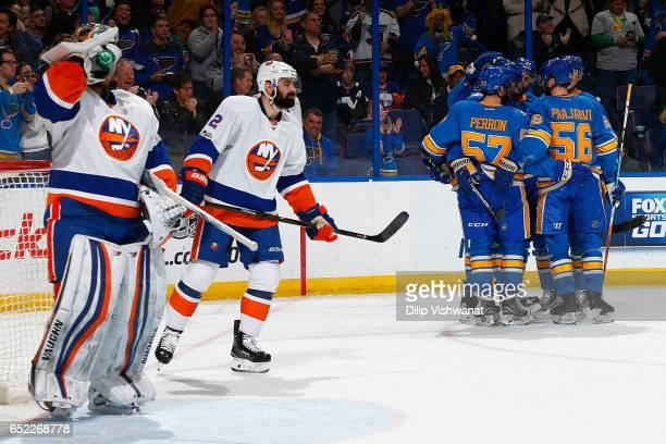 Members of the St Louis Blues celebrate after scoring a goal against Thomas Greiss and Nick Leddy of the New York Islanders at the Scottrade Center...