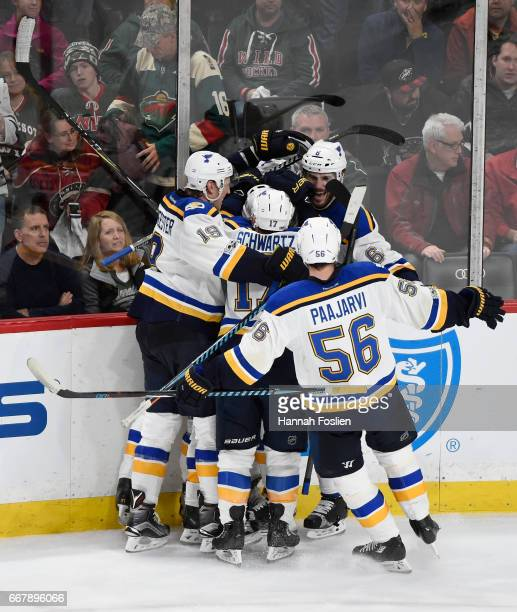 Members of the St Louis Blues celebrate the gamewinning goal against the Minnesota Wild by Joel Edmundson to end Game One of the Western Conference...
