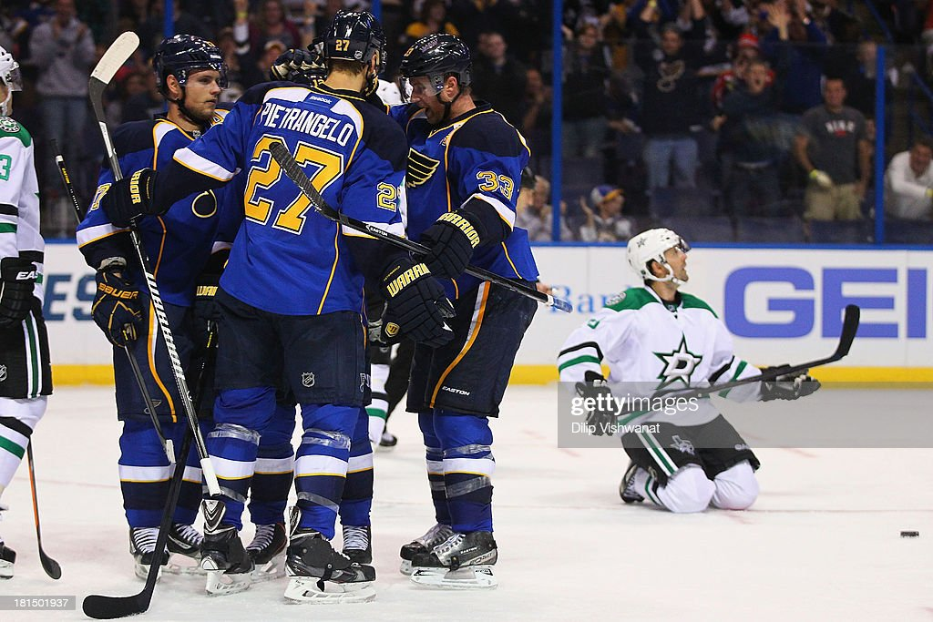 Members of the St. Louis Blues celebrate their game-tying goal against the Dallas Stars during a preseason at the Scottrade Center on September 21, 2013 in St. Louis, Missouri. The Blues beat the Stars 3-2 in overtime.