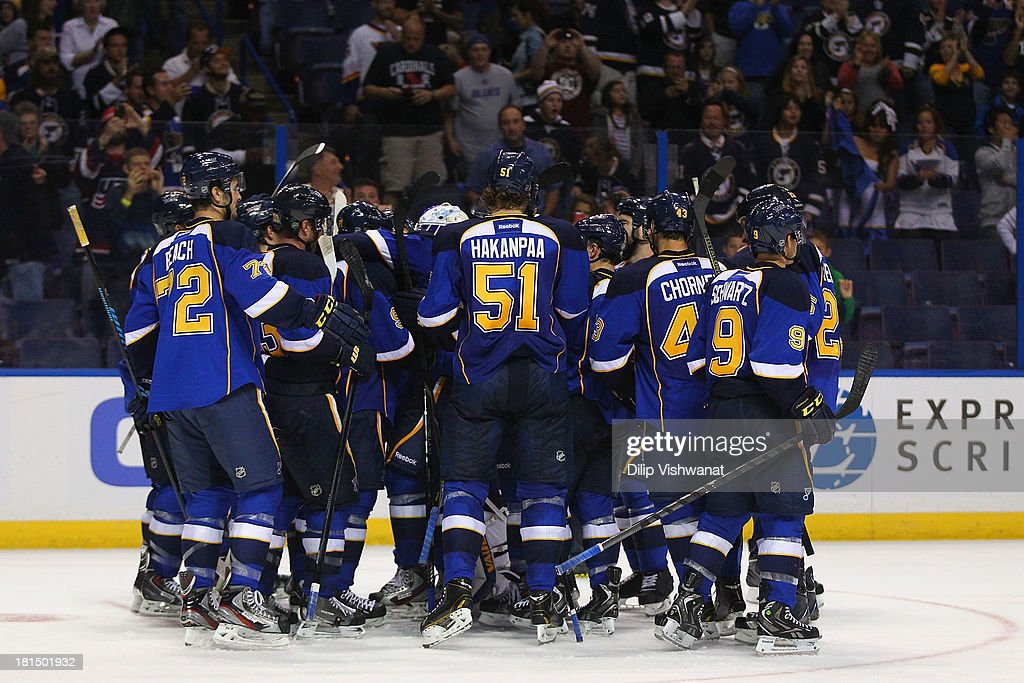 Members of the St. Louis Blues celebrate their game-winning goal against the Dallas Stars during a preseason at the Scottrade Center on September 21, 2013 in St. Louis, Missouri. The Blues beat the Stars 3-2 in overtime.