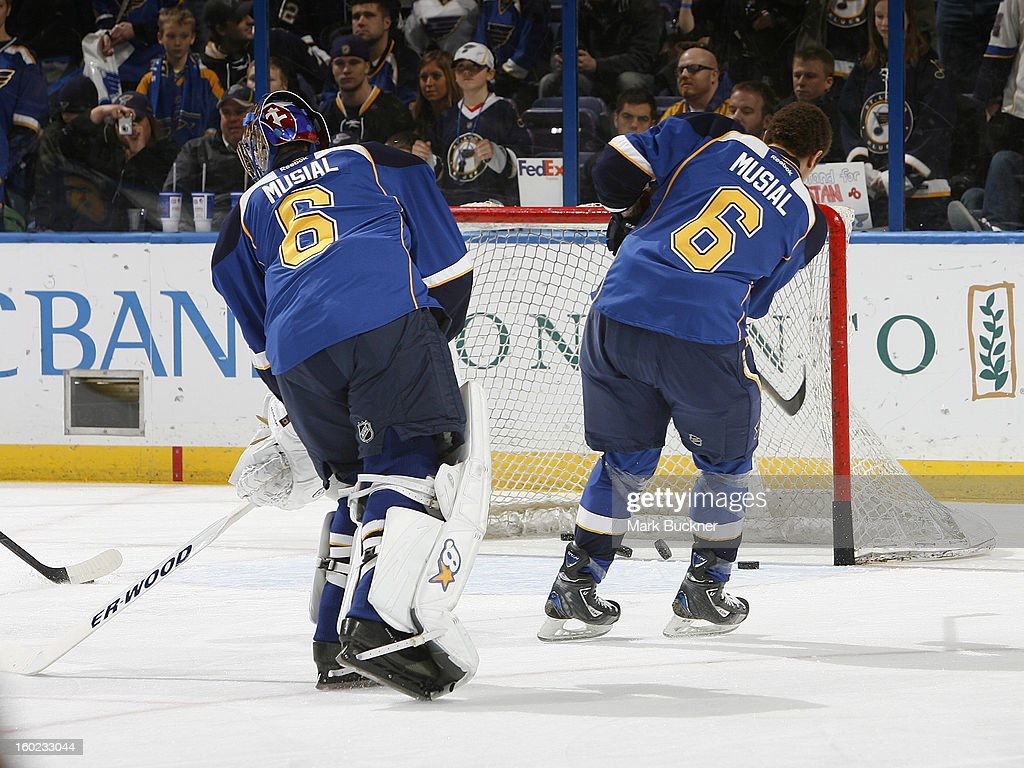 Members of the St. Louis Blues wear the number six on their jerseys to honor the S. Louis Cardinals great Stan Musial who recently passed away before an NHL game against the Minnesota Wild on January 27, 2013 at Scottrade Center in St. Louis, Missouri.