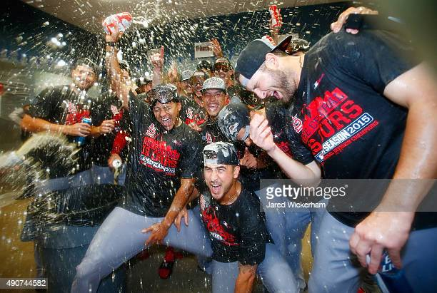 Members of the St Louis Cardinals including Carlos Martinez celebrates with teammates in the clubhouse following their division clinching 111 win...