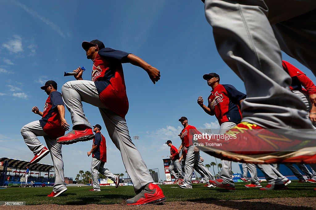 Members of the St Louis Cardinals warm up prior to the game against the New York Mets at Tradition Field on February 27 2013 in Port St Lucie Florida