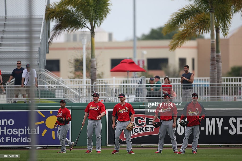 Members of the St. Louis Cardinals warm up prior to the start of the game against the Boston Red Sox at JetBlue Park on February 26, 2013 in Fort Myers, Florida.