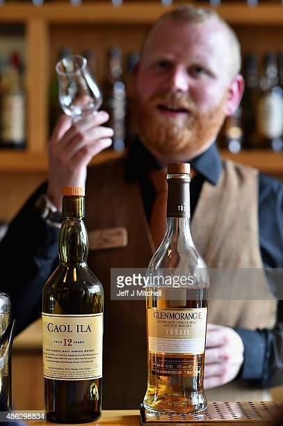 A members of the staff pours whisky into a glass at The Scotch Whisky Experience on September 3 2015 in EdinburghScotlandPlans to introduce a minimum...