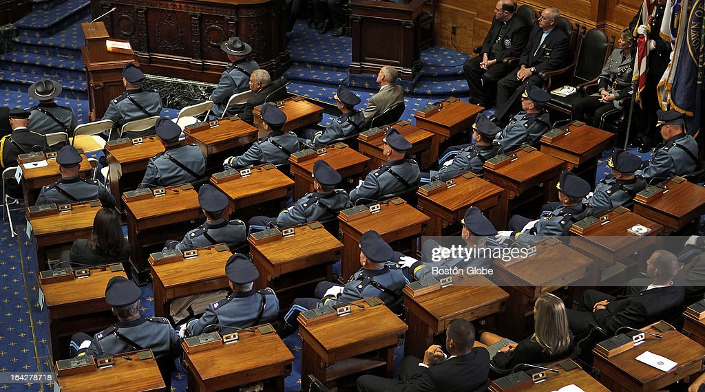 Members of the State Police at the desks of legislators in House of Representatives seats for the 26th annual Massachusetts Law Enforcement Memorial Vigil and Reading of the Roll at the State House in House Chambers.