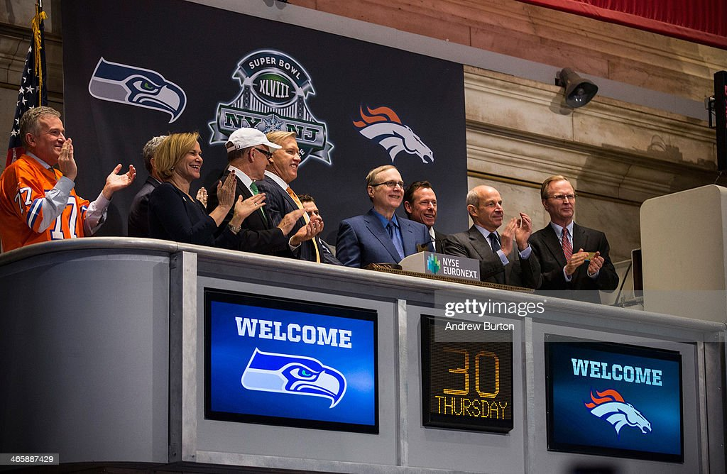 Members of the Super Bowl Host Committee, along with owners and managers of the Denver Broncos and Seattle Seahawks ring the opening bell of the New York Stock Exchange (NYSE) on the morning of January 30, 2014 in New York City. The NYSE welcomed members of the Super Bowl Host Committee, owners and managers of the Denver Broncos and Seattle Seahawks to ring the opening bell today.