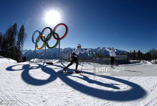 Members of the Sweden CrossCountry team ski past the Olympic rings ahead of the Sochi 2014 Winter Olympics at the Laura CrossCountry Ski and Biathlon...