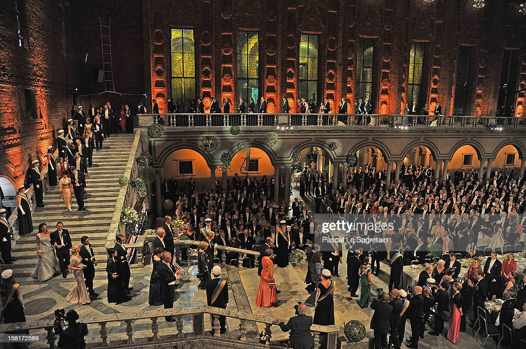Members of the Swedish Royal family and Nobel Prize laureates walk down the stairs as they arrive for Nobel Banquet at Town Hall on December 10, 2012 in Stockholm, Sweden.