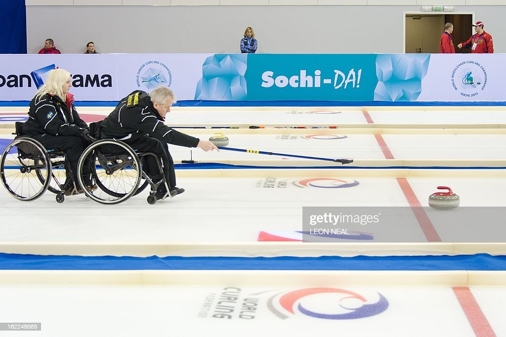 Members of the Swedish Wheelchair Curling team take part in a test event at the Olympic Curling Centre in Adler, Russia on February 21, 2013. With a year to go until the Sochi 2014 Winter Games, construction work continues as tests events and World Championship competitions are underway.