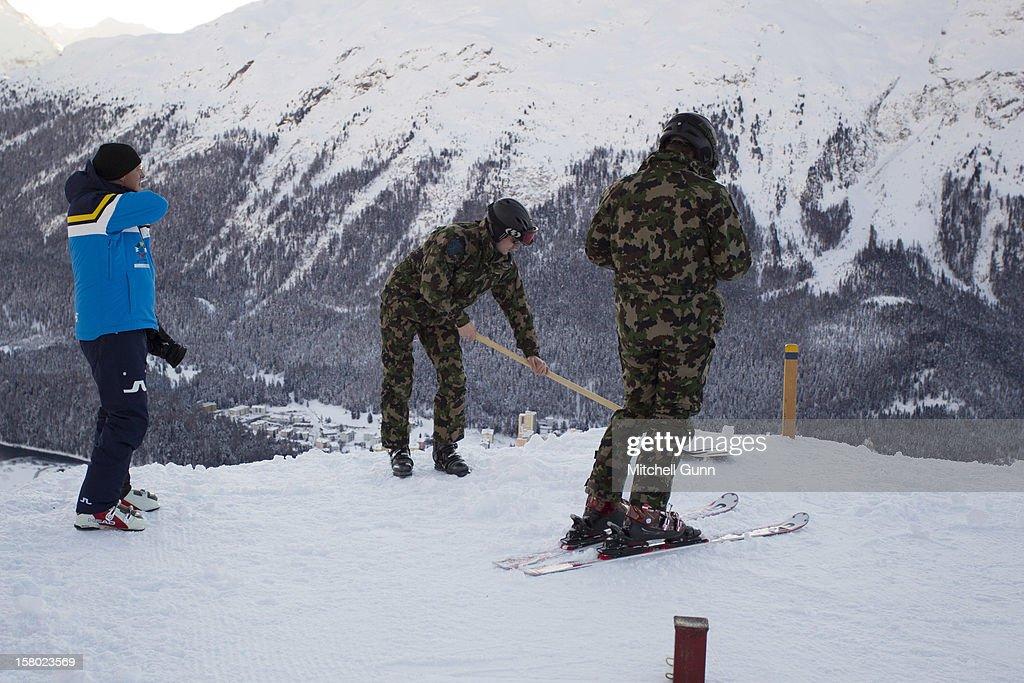 Members of the Swiss Army prepare the piste for the Audi FIS Alpine Ski World Giant Slalom race on December 9 2012 in St Moritz, Switzerland.
