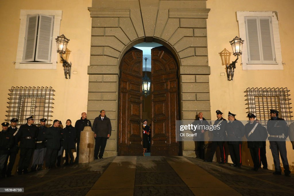 Members of the Swiss Guard close the doors to Pope Benedict XVI's residence in Castel Gandolfo as he starts his retirement today on February 28, 2013 in Castel Gandolfo, Italy. Pope Benedict XVI has been the leader of the Catholic Church for eight years and is the first Pope to retire since 1415. He will stay at the Papal Summer residence of Castel Gandolfo until renovations are complete at a monastery in the grounds of the Vatican and will be known as Emeritus Pope.