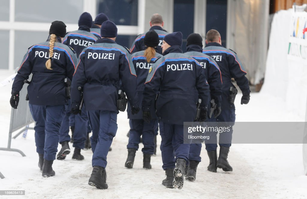 Members of the Swiss police force arrive at the Congress Centre ahead of the World Economic Forum (WEF) meeting in Davos, Switzerland, on Monday, Jan. 21, 2013. This week the business elite gathers in the Swiss Alps for the 43rd annual meeting of the World Economic Forum in Davos, the five day event runs from Jan. 23-27. Photographer: Simon Dawson/Bloomberg via Getty Images