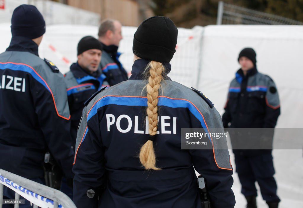 Members of the Swiss police force gather for a briefing outside the Congress Centre ahead of the World Economic Forum (WEF) meeting in Davos, Switzerland, on Monday, Jan. 21, 2013. This week the business elite gathers in the Swiss Alps for the 43rd annual meeting of the World Economic Forum in Davos, the five day event runs from Jan. 23-27. Photographer: Simon Dawson/Bloomberg via Getty Images