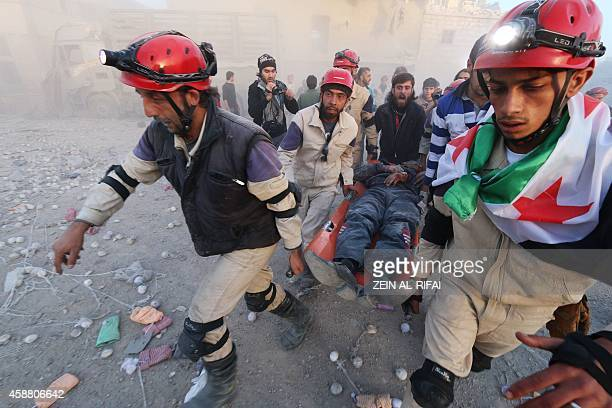 Members of the Syrian Civil Defence carry an injured man after an alleged air strike by Syrian government forces in the northern Syrian city of...