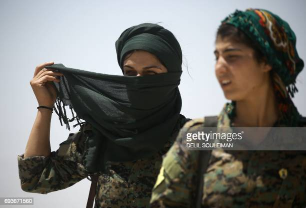 CORRECTION Members of the Syrian Democratic Forces made up of an alliance of Kurdish and Arab fighters stand some two kilometres from the AlMeshleb...