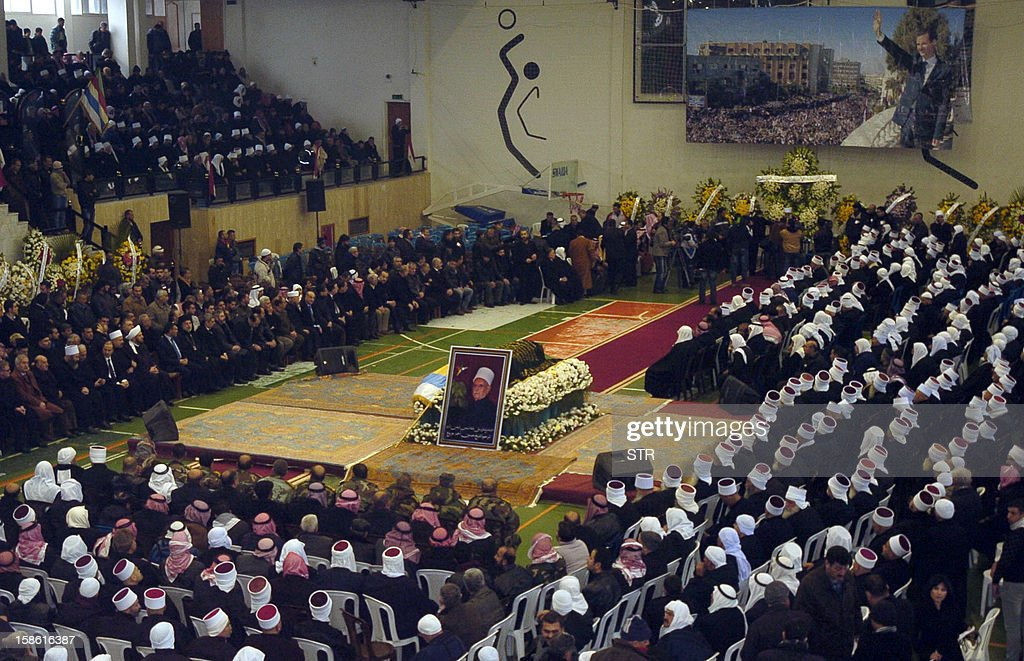 Members of the Syrian Druze community and government officials attend the funeral service of Sheikh Hussein al-Jarboua, a Druze religious leader in Syria and Lebanon who had close ties to the regime of President Bashar al-Assad, on December 21, 2012 in Damascus. Jarboua was 87 and died following a battle against cancer.