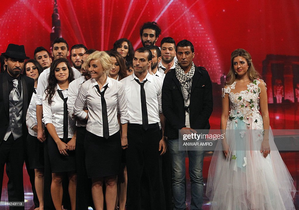 Members of the Syrian group Sima Palestinian painter Mohammad Al Diri and American singer Jennifer Grout wait for the final results of the panArab TV...