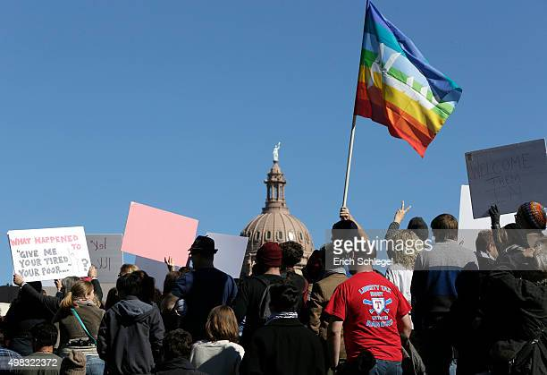 Members of The Syrian People Solidarity Group protest on November 22 2015 in Austin Texas The group was protesting Texas governor Greg Abbott's...