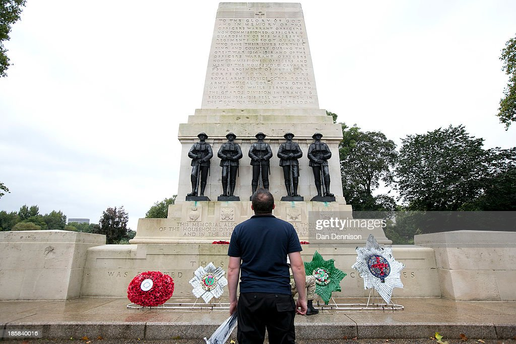 Members of the TA prepare Battalion wreaths for the (from left) Grenadier, Scots, Welsh, Irish and Coldstream Guards sit at the Guards Memorial ahead of a recruitment day on October 25, 2013 in London, England. The recruitment day sees TA units from the Greater London area getting together for a one-off, interactive experience that will demonstrate their wide-ranging skills and capabilities.