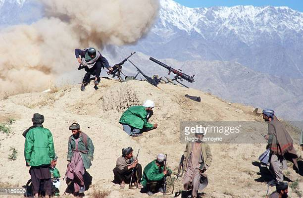 Members of the Taliban army fight on the front line October 21 1996 near Kabul Afghanistan The Taliban army faces opposition by the Northern Alliance...