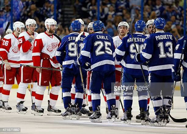 Members of the Tampa Bay Lightning and Detroit Red Wings shake hands after Game Seven of the Eastern Conference Quarterfinals during the 2015 NHL...