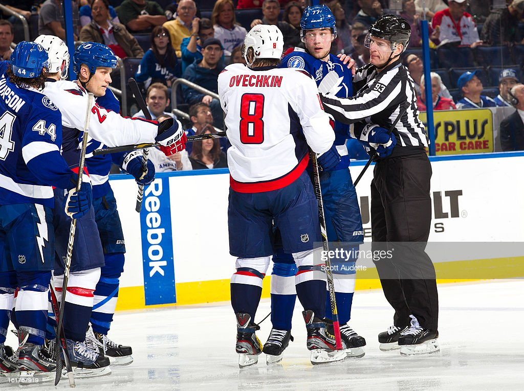 Members of the Tampa Bay Lightning and Washington Capitals fight during the second period of the game at the Tampa Bay Times Forum on February 14, 2013 in Tampa, Florida.