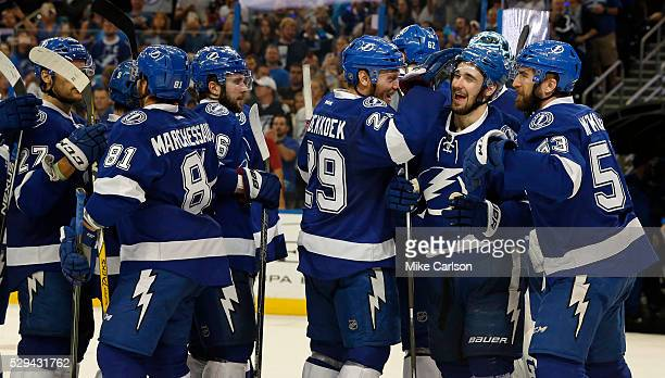 Members of the Tampa Bay Lightning celebrate a series win over the New York Islanders after Game Five of the Eastern Conference Second Round during...