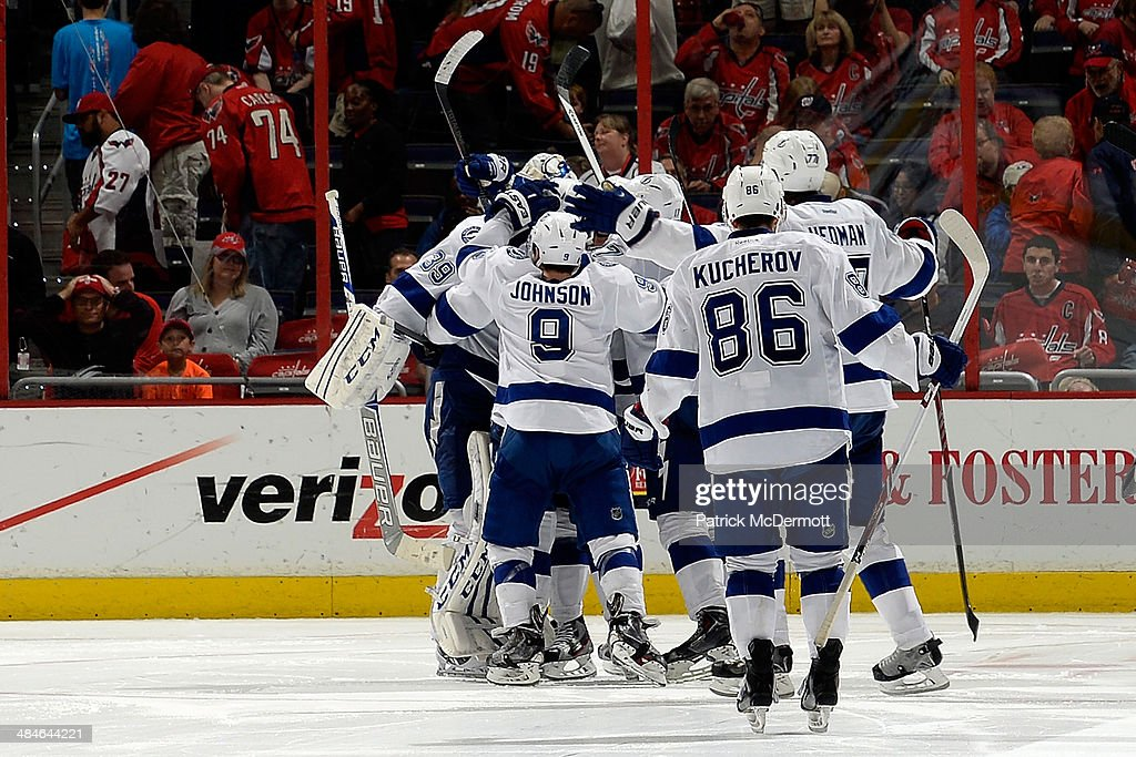 Members of the Tampa Bay Lightning celebrate after defeating the Washington Capitals 1-0 in a shootout during an NHL game at Verizon Center on April 13, 2014 in Washington, DC.