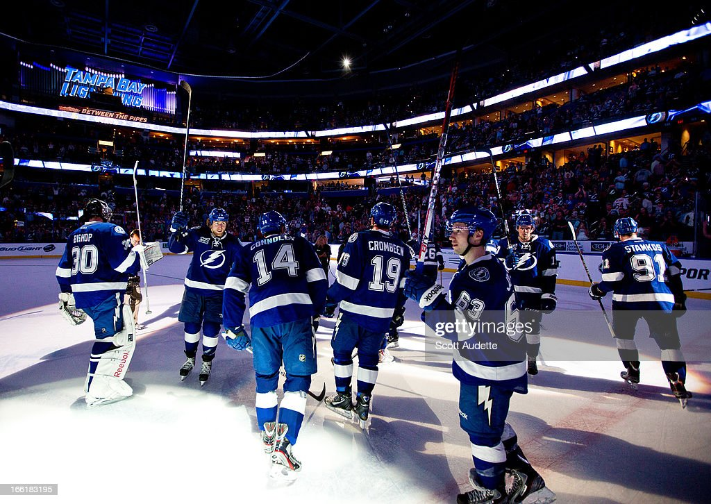 Members of the Tampa Bay Lightning celebrate after defeating the Ottawa Senators 3-2 at the Tampa Bay Times Forum on April 9, 2013 in Tampa, Florida.