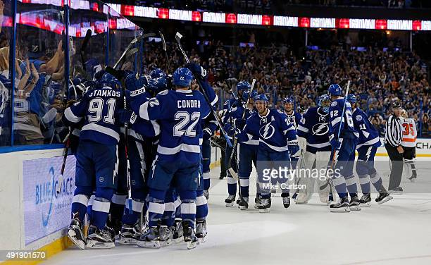 Members of the Tampa Bay Lightning celebrate an overtime win over the Philadelphia Flyers at the Amalie Arena on October 8 2015 in Tampa Florida