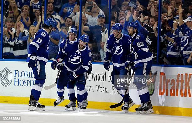 Members of the Tampa Bay Lightning including Brian Boyle Nikita Kucherov Andrej Sustr and Braydon Coburn celebrate a goal against the Ottawa Senators...