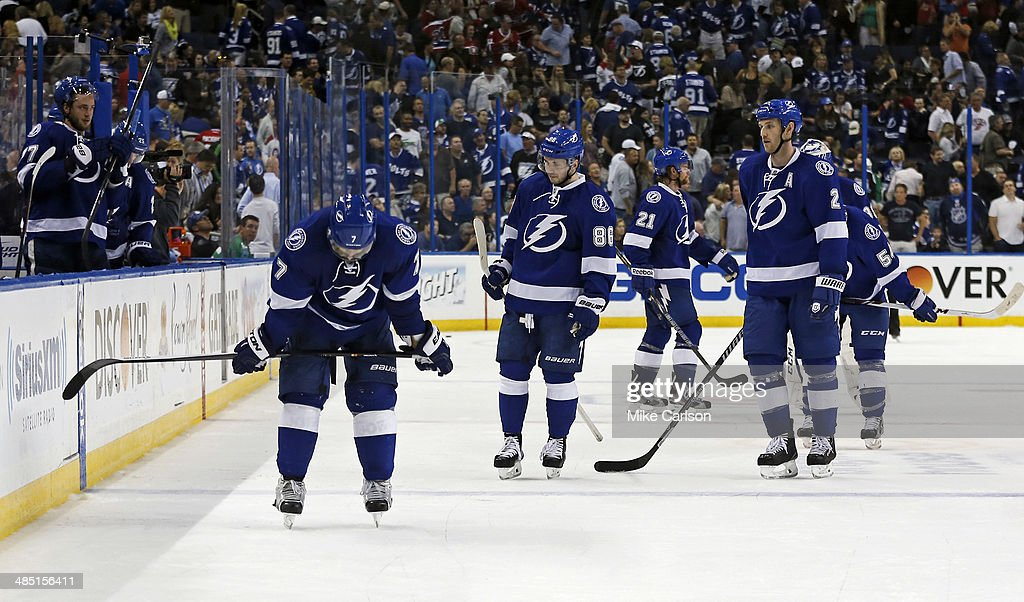 Members of the Tampa Bay Lightning, including <a gi-track='captionPersonalityLinkClicked' href=/galleries/search?phrase=Radko+Gudas&family=editorial&specificpeople=5648763 ng-click='$event.stopPropagation()'>Radko Gudas</a> #7, <a gi-track='captionPersonalityLinkClicked' href=/galleries/search?phrase=Nikita+Kucherov&family=editorial&specificpeople=7832285 ng-click='$event.stopPropagation()'>Nikita Kucherov</a> #86, <a gi-track='captionPersonalityLinkClicked' href=/galleries/search?phrase=Mike+Kostka&family=editorial&specificpeople=2193393 ng-click='$event.stopPropagation()'>Mike Kostka</a> #21 and <a gi-track='captionPersonalityLinkClicked' href=/galleries/search?phrase=Eric+Brewer&family=editorial&specificpeople=202144 ng-click='$event.stopPropagation()'>Eric Brewer</a> #2 react after giving up an overtime goal to the Montreal Canadiens in Game One of the First Round of the 2014 Stanley Cup Playoffs at the Tampa Bay Times Forum on April 16, 2014 in Tampa, Florida.