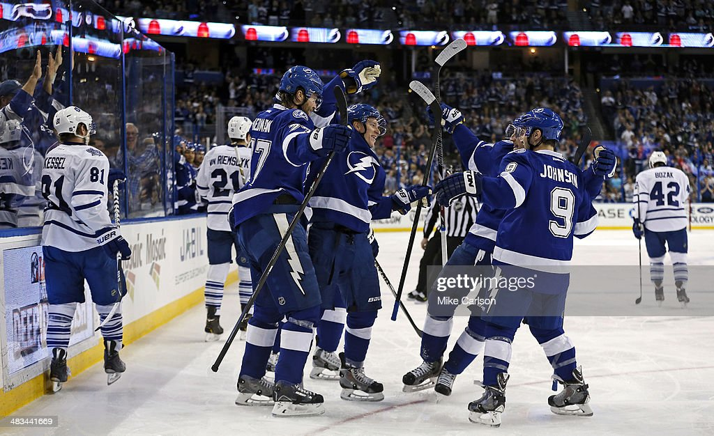 Members of the Tampa Bay Lightning (L-R) <a gi-track='captionPersonalityLinkClicked' href=/galleries/search?phrase=Victor+Hedman&family=editorial&specificpeople=4784238 ng-click='$event.stopPropagation()'>Victor Hedman</a> #77, Ondrej Palat; <a gi-track='captionPersonalityLinkClicked' href=/galleries/search?phrase=Steven+Stamkos&family=editorial&specificpeople=4047623 ng-click='$event.stopPropagation()'>Steven Stamkos</a> #91, and <a gi-track='captionPersonalityLinkClicked' href=/galleries/search?phrase=Tyler+Johnson+-+Ice+Hockey+Player&family=editorial&specificpeople=14574766 ng-click='$event.stopPropagation()'>Tyler Johnson</a> #9 celebrate a goal as members of the Toronto Maple Leafs react at the Tampa Bay Times Forum on April 8, 2014 in Tampa, Florida.