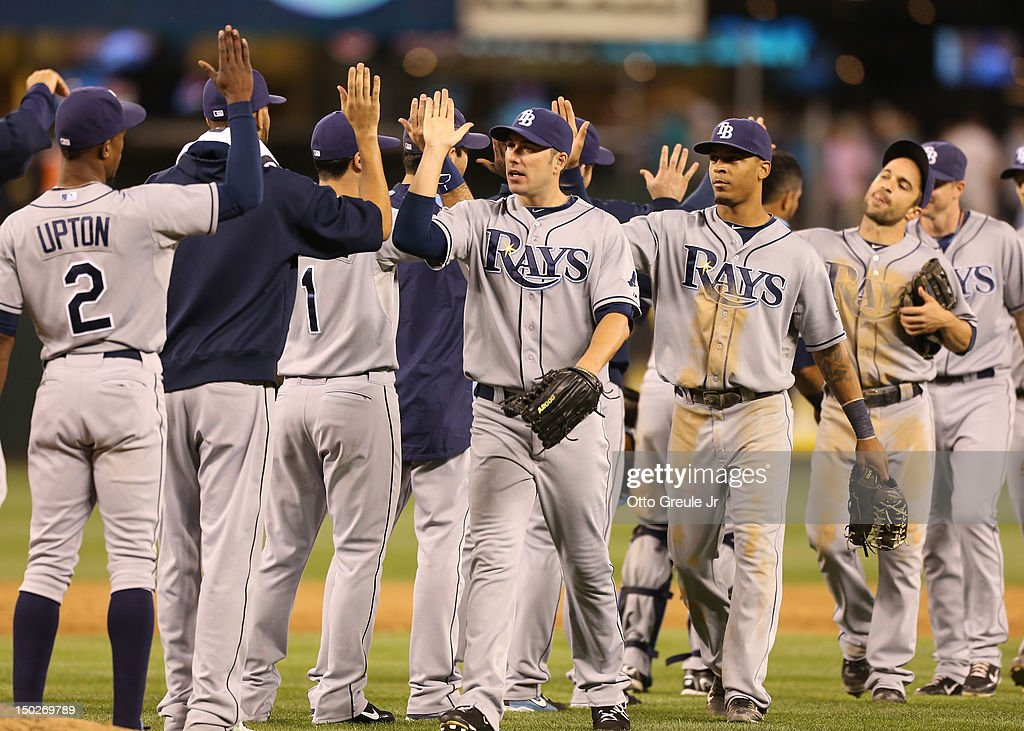 Members of the Tampa Bay Rays celebrate after defeating the Seattle Mariners 4-1 at Safeco Field on August 13, 2012 in Seattle, Washington.