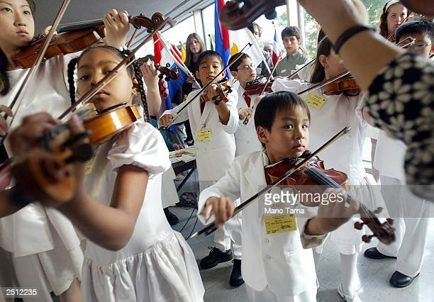 Members of the Tarumi Violin Children's Foundation for the Arts perform at United Nations headquarters in observance of the International Day of...