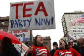 Members of the Tea Party movement protest outside the Fairmont Hotel before US President Barack Obama arrives for a fundraiser May 25 2010 in San...