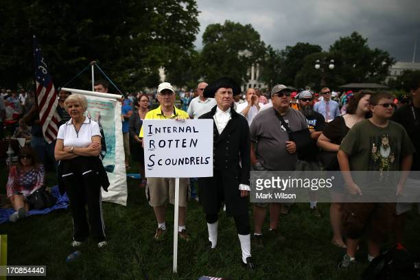 Members of the Tea Party participate in a rally at the US Capitol June 19 2013 in Washington DC The group Tea Party Patriots hosted the rally to...