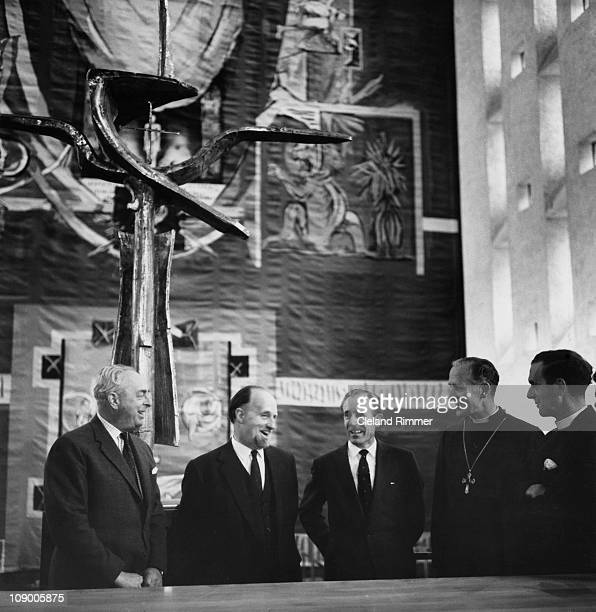 Members of the team responsible for the new Coventry Cathedral standing under the high altar in the newlycompleted building 23rd May 1962 The team...