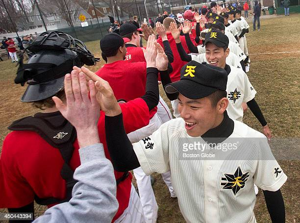 Members of the Tennoji High School baseball team from Osaka Japan played an exhibition game against defending state champions Hingham High School at...
