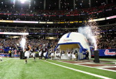 Members of the Texas AM Aggies take the field before the ChickFilA Bowl against the Duke Blue Devils at the Georgia Dome on December 31 2013 in...