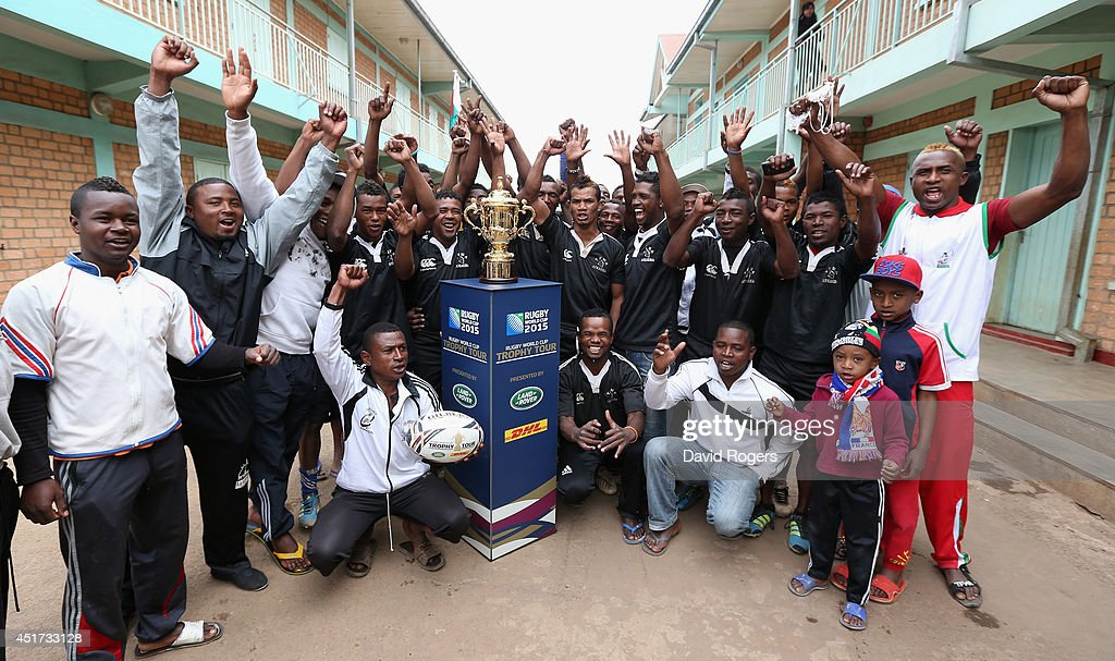 Members of the TFMA Rugby Club pose with the Webb Ellis Cup during a visit to Ankasina during the Rugby World Cup Trophy Tour in Madagascar in partnership with Land Rover and DHL ahead of Rugby World Cup 2015 on July 5, 2014 in Antananarivo, Madagascar.