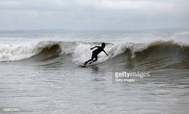 COX'S BAZAR BANGLADESH OCTOBER 22 Members of the The Cox's Bazar Lifesaving Surfing Club surf on October 22 2013 in Cox's Bazar Bangladesh The Cox's...