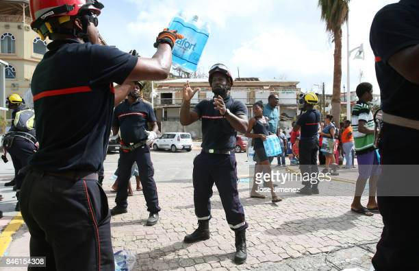 Members of the the Martinique Fireman Unit unload water for residents of Marigot Saint Maarten days after this Caribbean island sustained extensive...