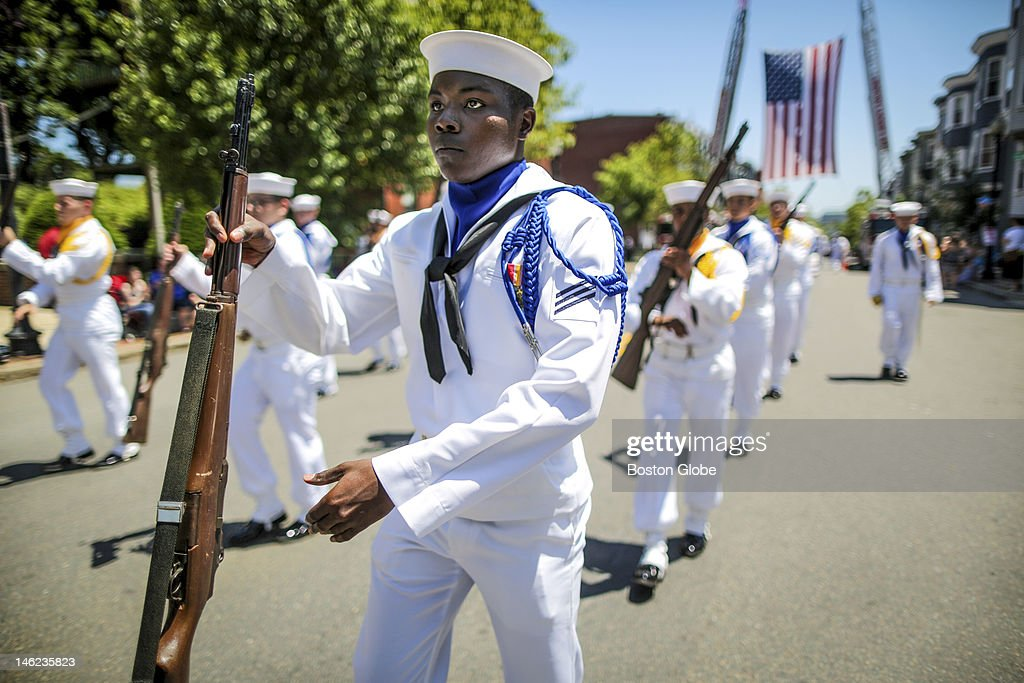 Members of the the Sub Base Groton Drill Team march along Bunker Hill Street during the Annual Bunker Hill Day Parade in Charlestown.