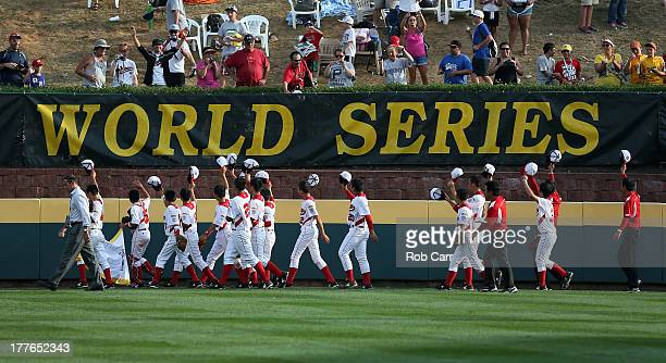 Members of the Tokyo Japan team celebrate after defeating the West team from Chula Vista Ca 64 during the Little League World Series Championship...