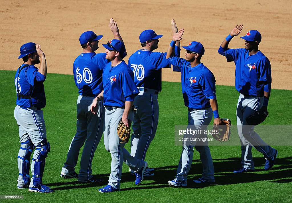 Members of the Toronto Blue Jays celebrate after the spring training game against the New York Yankees at George M. Steinbrenner Field on February 28, 2013 in Tampa, Florida.