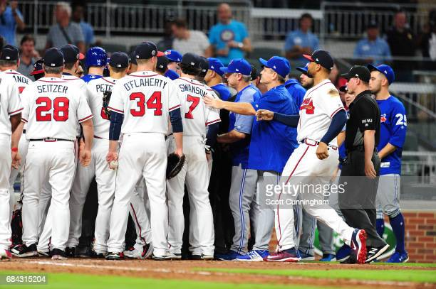 Members of the Toronto Blue Jays come together with the Atlanta Braves during an eighth inning scuffle at SunTrust Park on May 17 2017 in Atlanta...